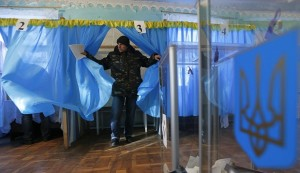 A man walks out of a voting booth during a parliamentary election at a polling station in Horodyshche near Chernihiv, October 26, 2014. Ukrainians voted on Sunday in an election that is likely to install a pro-Western parliament and strengthen President Petro Poroshenko's mandate to end separatist conflict in the east, but may fuel tension with Russia. REUTERS/Stringer (UKRAINE - Tags: POLITICS ELECTIONS CIVIL UNREST)