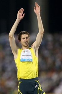 Ukraine's Bohdan Bondarenko celebrates after winning the men's high jump at the IAAF Diamond League in the Qatari capital Doha on May 10, 2013. AFP PHOTO / AL-WATAN DOHA / KARIM JAAFAR == QATAR OUT ==